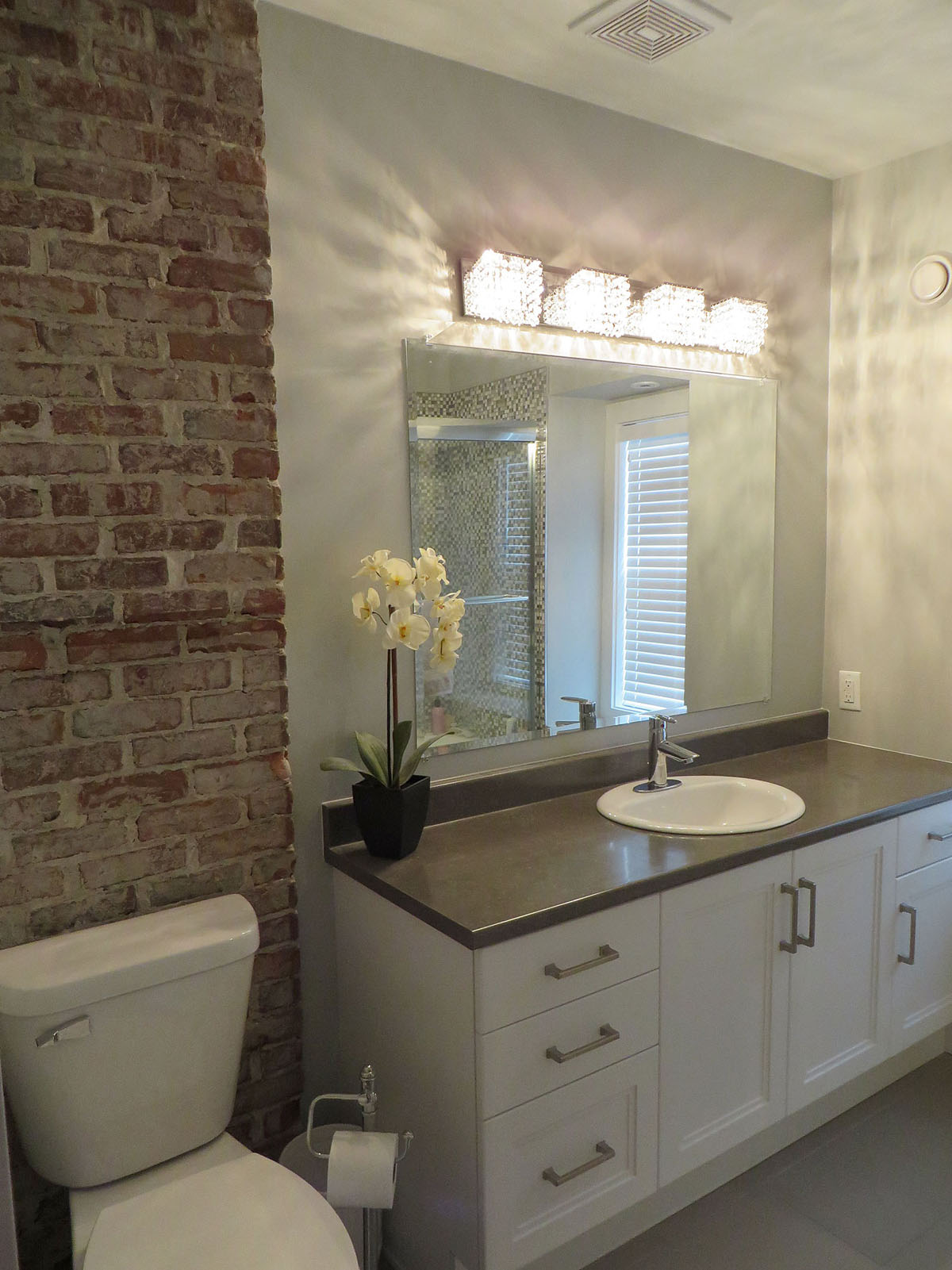 Safe, elegant bathroom lighting, GFI outlets, and fan.