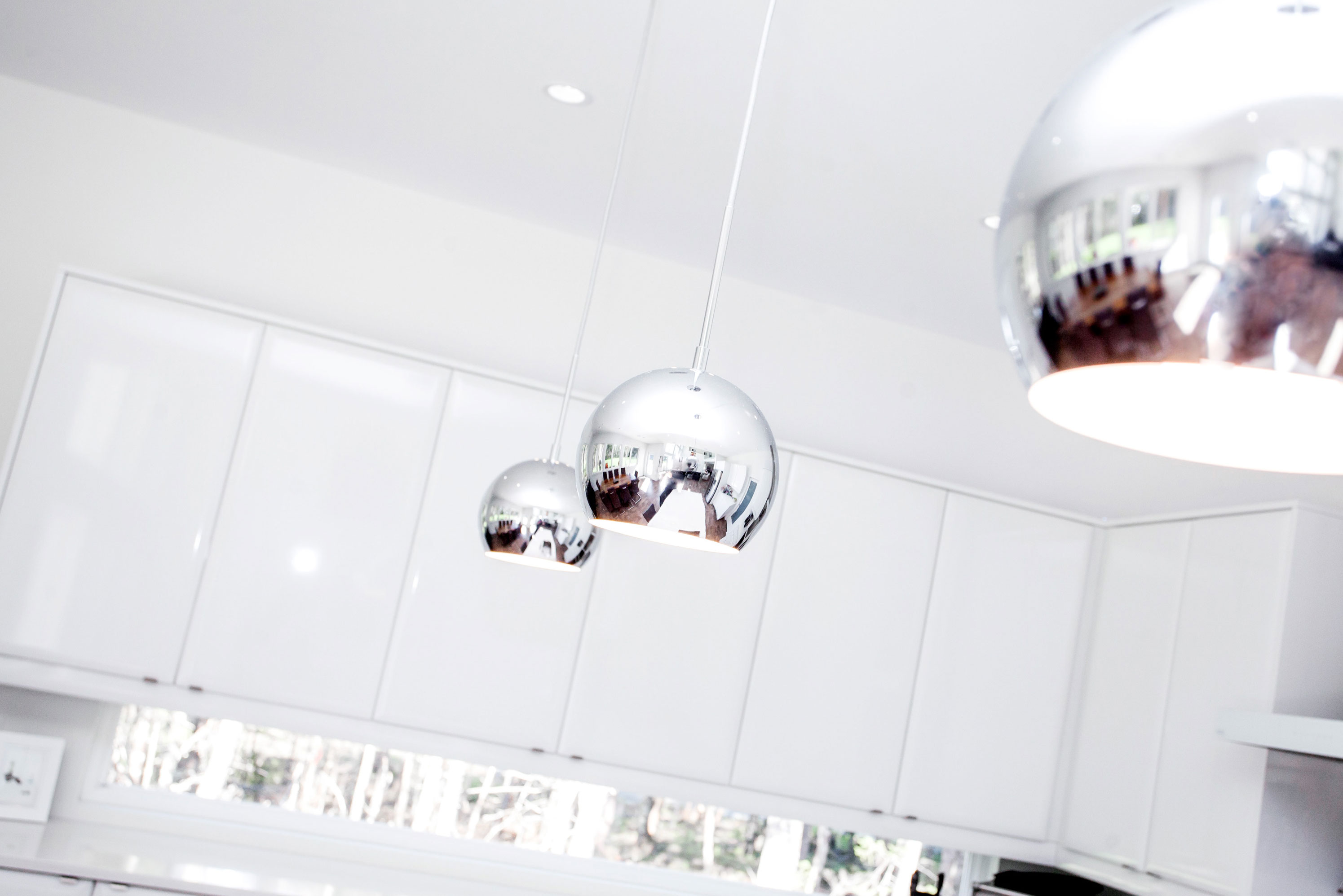 These adventurous pendant lights enliven a modern space.